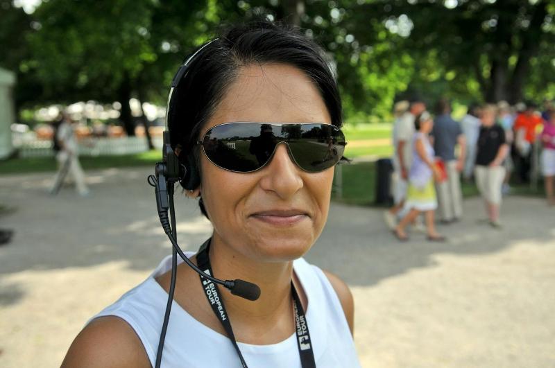 Charulata wearing headphone and mic at work
